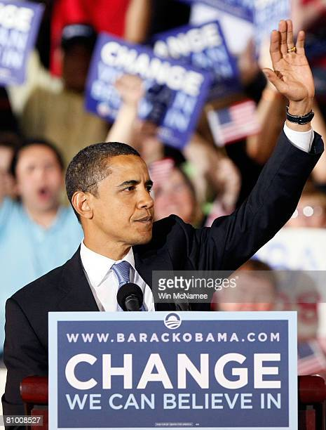 Democratic presidential candidate Sen Barack Obama waves to supporters while finishing his speech at a primary night rally at North Carolina State...
