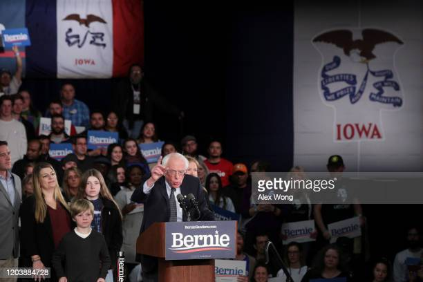 Democratic presidential candidate Sen Bernie Sanders addresses supporters during his caucus night watch party on February 03 2020 in Des Moines Iowa...