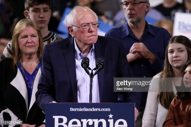 Democratic presidential candidate Sen Bernie Sanders addresses supporters beside his wife Jane Sanders at his Super Tuesday night event on March 03...