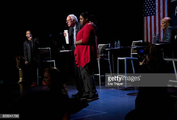 Democratic presidential candidate Sen Bernie Sanders and Erica Garner daughter of the late Eric Garner at a Community Conversation at the Apollo...