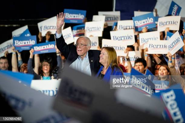 Democratic presidential candidate Sen. Bernie Sanders and his wife Jane Sanders wave as they exit the stage after winning the Nevada caucuses during...