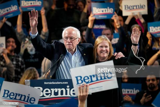 Democratic presidential candidate Sen Bernie Sanders and his wife Jane Sanders wave at the end of a campaign rally at the University of Houston on...