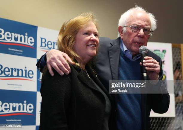 Democratic presidential candidate Sen Bernie Sanders and his wife Jane Sanders stand together during a stop at a campaign field office on February 02...