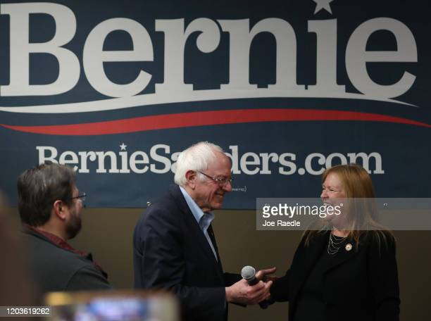Democratic presidential candidate Sen. Bernie Sanders and his wife, Jane Sanders, stand together during a stop at a campaign field office on February...