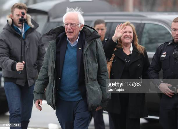 Democratic presidential candidate Sen Bernie Sanders and his wife Jane Sanders arrive to greet people campaigning for him outside of a polling...