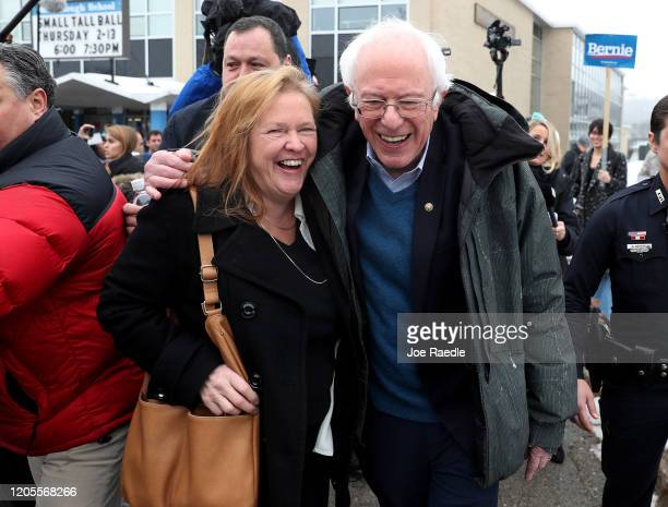 Democratic presidential candidate Sen Bernie Sanders and his wife Jane Sanders walk together after greeting people campaigning for him outside of a...