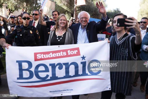 Democratic presidential candidate Sen Bernie Sanders and his wife Jane Sanders participate in a march after a campaign rally at University of Nevada...