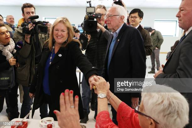Democratic presidential candidate Sen. Bernie Sanders and his wife Jane O'Meara Sanders say goodbye to poll workers after voting in their state's...