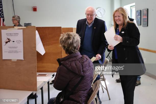 Democratic presidential candidate Sen. Bernie Sanders and his wife Jane O'Meara Sanders greet other voters after filling out their ballots in their...