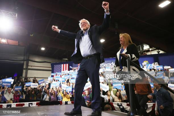 Democratic presidential candidate Sen Bernie Sanders and his wife Jane O'Meara Sanders take the stage during a Super Tuesday night rally with at the...