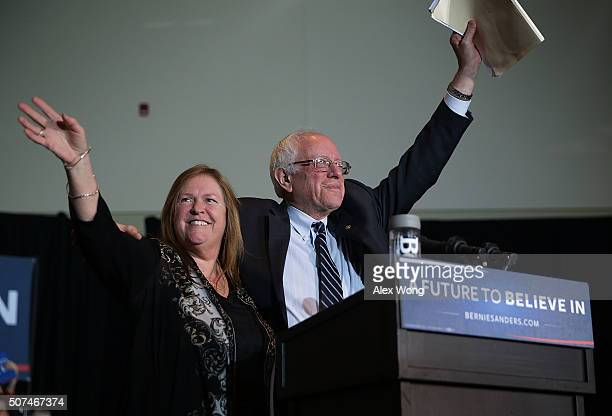 Democratic presidential candidate Sen Bernie Sanders and his wife Jane O'Meara Sanders wave on stage during a campaign rally at Grand River Event...
