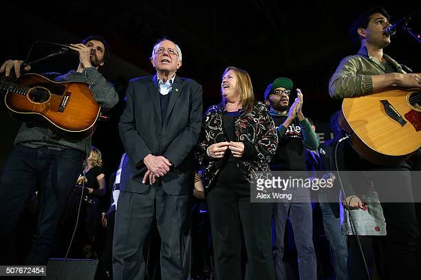 Democratic presidential candidate Sen Bernie Sanders and his wife Jane O'Meara Sanders on stage with performing musicians during a campaign rally at...