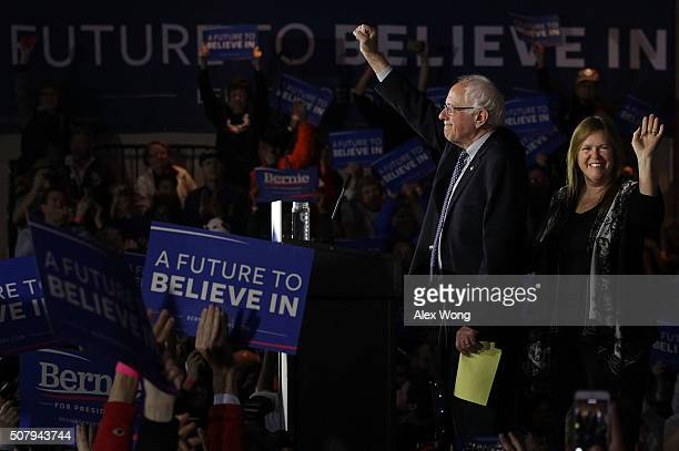 Democratic presidential candidate Sen. Bernie Sanders and his wife Jane O'Meara Sanders acknowledge supporters during a caucus night party February...