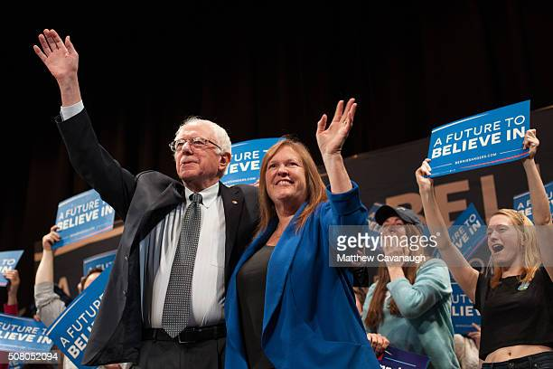 Democratic presidential candidate Sen Bernie Sanders and his wife Jane O'Meara Sanders wave to the crowd as they take the stage at the Claremont...