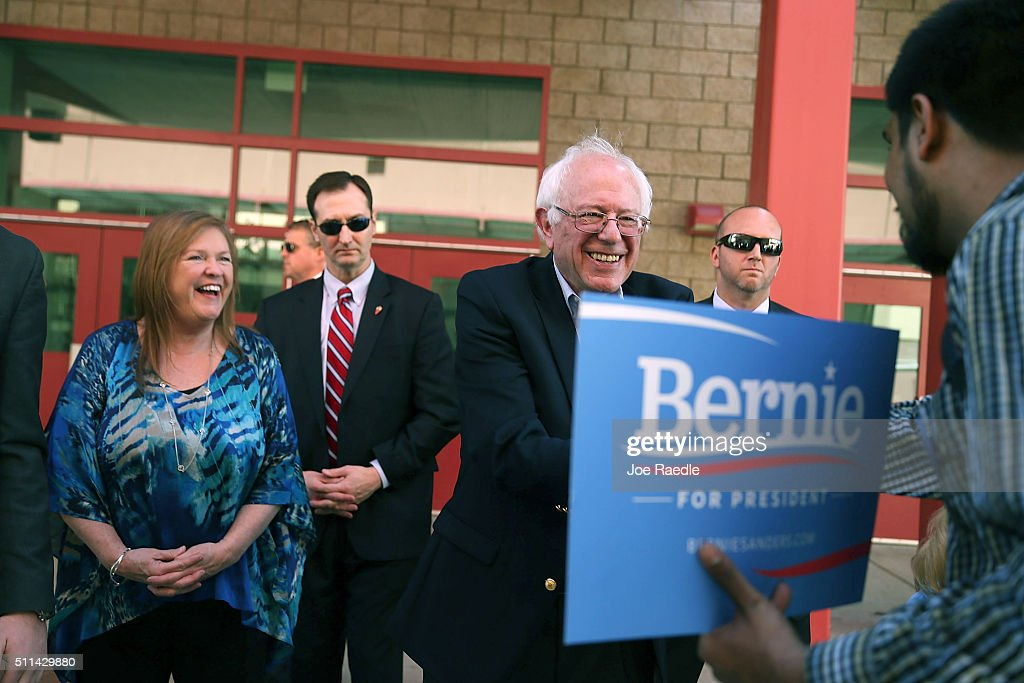 Democratic presidential candidate Sen. Bernie Sanders (D-VT) and his wife, Jane O'Meara Sanders, (L) greet voters as they visit the Western High School caucus site on February 20, 2016 in Las Vegas, Nevada. Sanders and Hillary Clinton wait for the voters to weigh in as they head to the polls in the Democratic caucus.