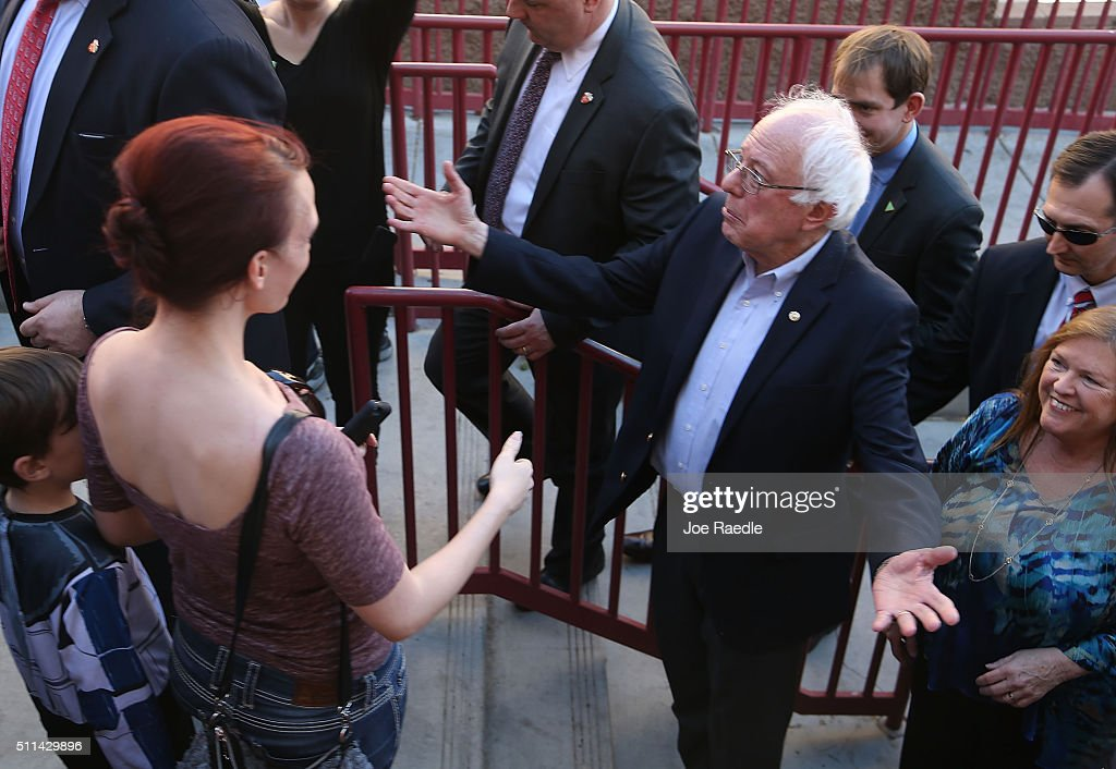 Democratic presidential candidate Sen. Bernie Sanders (D-VT) and his wife, Jane O'Meara Sanders, (R) greet voters as they visit the Western High School caucus site on February 20, 2016 in Las Vegas, Nevada. Sanders and Hillary Clinton wait for the voters to weigh in as they head to the polls in the Democratic caucus.