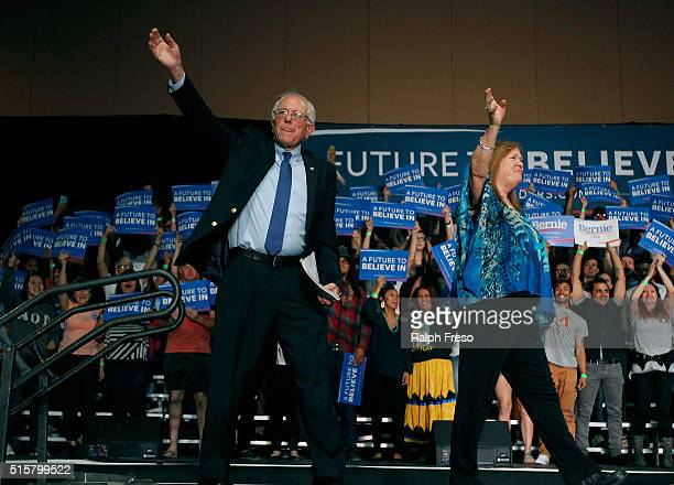 Democratic presidential candidate Sen Bernie Sanders and his wife Jane wave to the crowd at the Phoenix Convention Center during a campaign rally on...