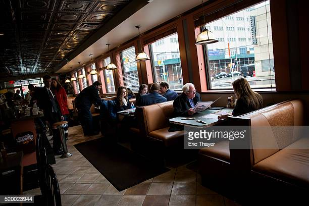 Democratic presidential candidate Sen Bernie Sanders and his wife Jane visit the Van Dam diner on April 9 2016 in the Queens borough of New York City...