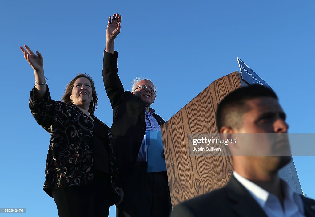 Democratic presidential candidate Sen. Bernie Sanders (R) and his wife Jane O'Meara Sanders greet supporters during a campaign rally at Waterfront Park on May 18, 2016 in Vallejo, California. A day after winning the Oregon primary, Bernie Sanders is campaigning in California ahead of the state's presidential primary on June 7.