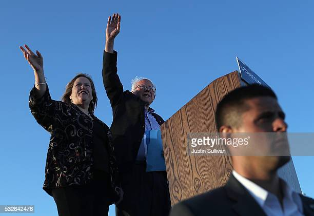 Democratic presidential candidate Sen Bernie Sanders and his wife Jane O'Meara Sanders greet supporters during a campaign rally at Waterfront Park on...
