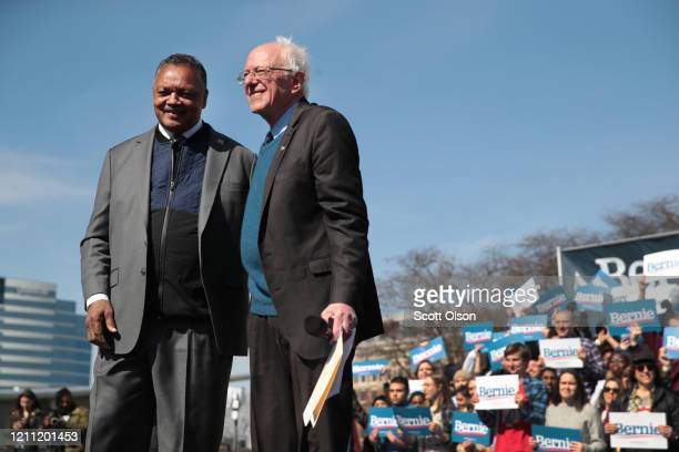 Democratic presidential candidate Sen Bernie Sanders and Rev Jesse Jackson greet the crowd during a campaign rally in Calder Plaza on March 08 2020...
