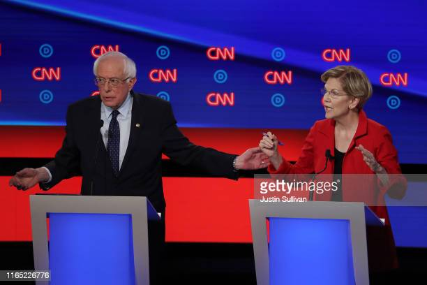 Democratic presidential candidate Sen Bernie Sanders and Sen Elizabeth Warren speak during the Democratic Presidential Debate at the Fox Theatre July...