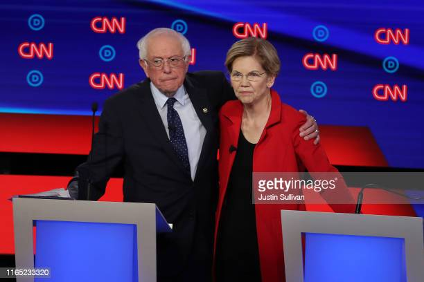 Democratic presidential candidate Sen. Bernie Sanders and Sen. Elizabeth Warren embrace after the Democratic Presidential Debate at the Fox Theatre...