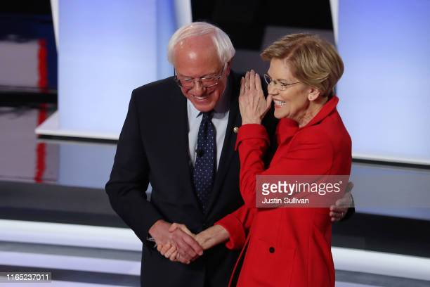 Democratic presidential candidate Sen Bernie Sanders and Sen Elizabeth Warren greet each other at the start of the Democratic Presidential Debate at...