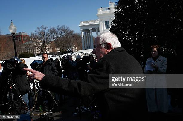 Democratic presidential candidate Sen Bernie Sanders answers questions outside the White House after meeting with US President Barack Obama January...