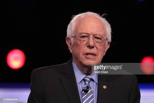Democratic presidential candidate Sen Bernie Sanders arrives on stage for the Democratic presidential primary debate at the Charleston Gaillard...