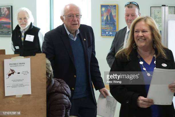 Democratic presidential candidate Sen Bernie Sanders cast his vote with his wife Jane O'Meara Sanders at a polling place March 3 2020 at Robert...