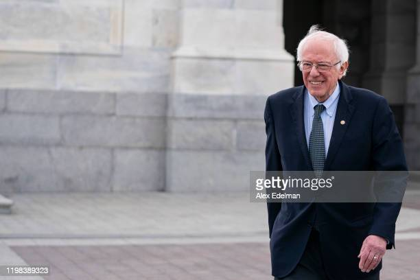 Democratic Presidential candidate Sen Bernie Sanders departs the US Capitol following closing arguments in the Senate impeachment trial of US...