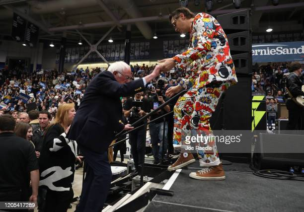 Democratic presidential candidate Sen Bernie Sanders follows Julian Casablancas the lead singer of the band The Strokes onto the stage during a...