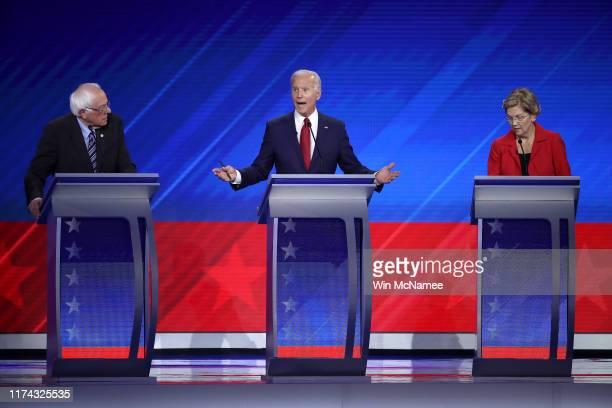 Democratic presidential candidate Sen. Bernie Sanders , former Vice President Joe Biden, and Sen. Elizabeth Warren debate on stage during the...