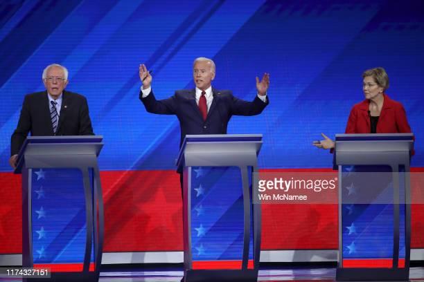 Democratic presidential candidate Sen. Bernie Sanders , former Vice President Joe Biden, and Sen. Elizabeth Warren interact on stage during the...