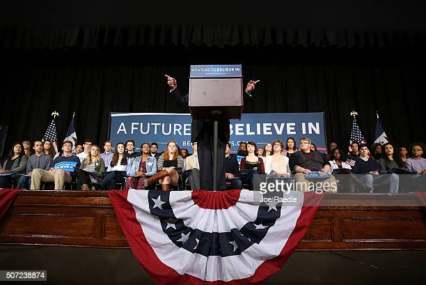 Democratic presidential candidate Sen Bernie Sanders gestures as he speaks from behind his podium during a forum at Roosevelt High School on January...