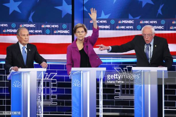 Democratic presidential candidate Sen Bernie Sanders gestures as Sen Elizabeth Warren and former New York City mayor Mike Bloomberg listen during the...
