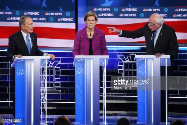 Democratic presidential candidate Sen Bernie Sanders gestures as Sen Elizabeth Warren and former New York City mayor Mike Bloomberg listen during the...
