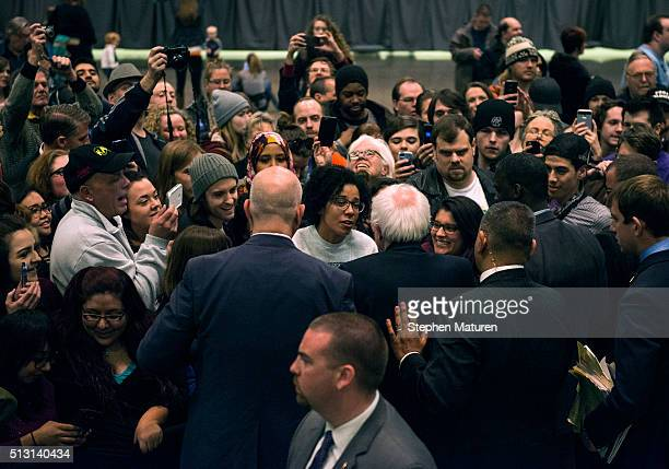 Democratic presidential candidate Sen Bernie Sanders greets a crowd of supporters after speaking at the Minneapolis Convention Center February 29...