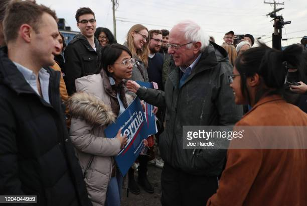 Democratic presidential candidate Sen Bernie Sanders greets a group of supporters after arriving in New Hampshire on February 04 2020 in Des Moines...