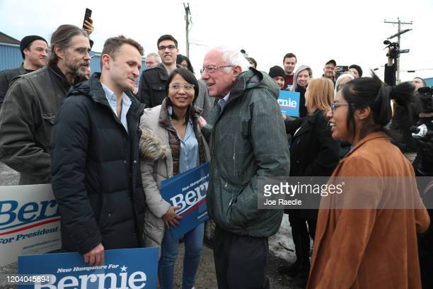 Democratic presidential candidate Sen Bernie Sanders greets a group of supporters after arriving in New Hampshire on February 04 2020 in Manchester...