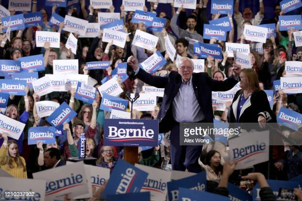 Democratic presidential candidate Sen Bernie Sanders greets supporters at his Super Tuesday night event on March 03 2020 in Essex Junction Vermont...