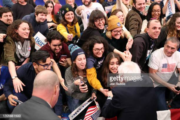Democratic presidential candidate Sen Bernie Sanders greets supporters during a primary night event on February 11 2020 in Manchester New Hampshire...