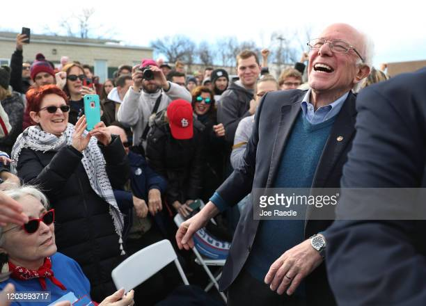 Democratic presidential candidate Sen Bernie Sanders greets people during a stop at a campaign field office on February 02 2020 in Cedar Rapids Iowa...