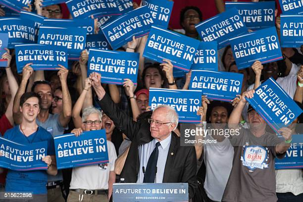 Democratic presidential candidate Sen Bernie Sanders greets the crowd at a campaign rally March 14 2016 in Charlotte North Carolina The North...