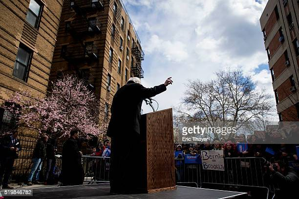 Democratic presidential candidate Sen Bernie Sanders holds a rally outside his childhood home in Flatbush on April 8 2016 in the Brooklyn borough of...
