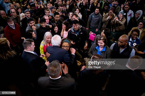 Democratic presidential candidate Sen Bernie Sanders hugs a supporter at a campaign rally at Bronx Community College on April 9 2016 in the Bronx...