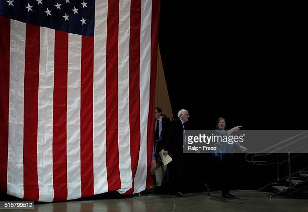 Democratic presidential candidate Sen Bernie Sanders is directed by his wife Jane as he arrives at the Phoenix Convention Center for a campaign rally...