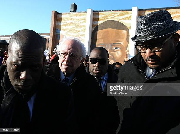Democratic presidential candidate Sen Bernie Sanders is escorted during a tour of SandtownWinchester Neighborhood where Freddie Gray lived and was...
