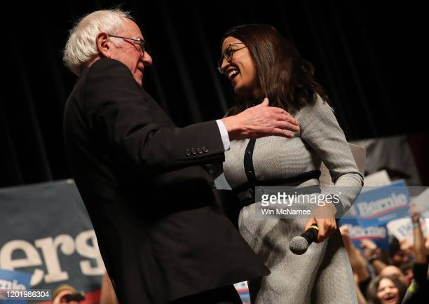 Democratic presidential candidate Sen Bernie Sanders is greeted by Rep Alexandria OcasioCortez after she introduced him at a campaign event at the...